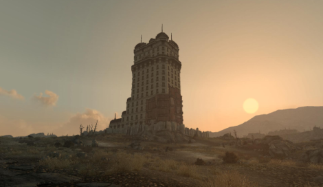 Tenpenny Towers hotel from Fallout 3, seen from a distance against a sunset in the background.