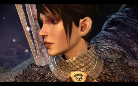 Morrigan from Dragon Age: Origins, a dark-haired, fair skinned woman seen in profile wearing a staff and mage's robes.